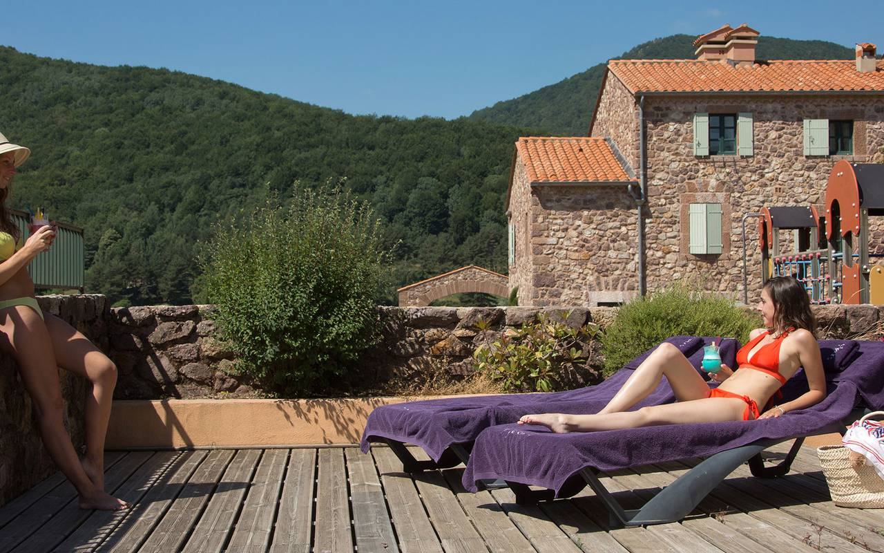 Women sunbathing hotel with swimming pool languedoc roussillon