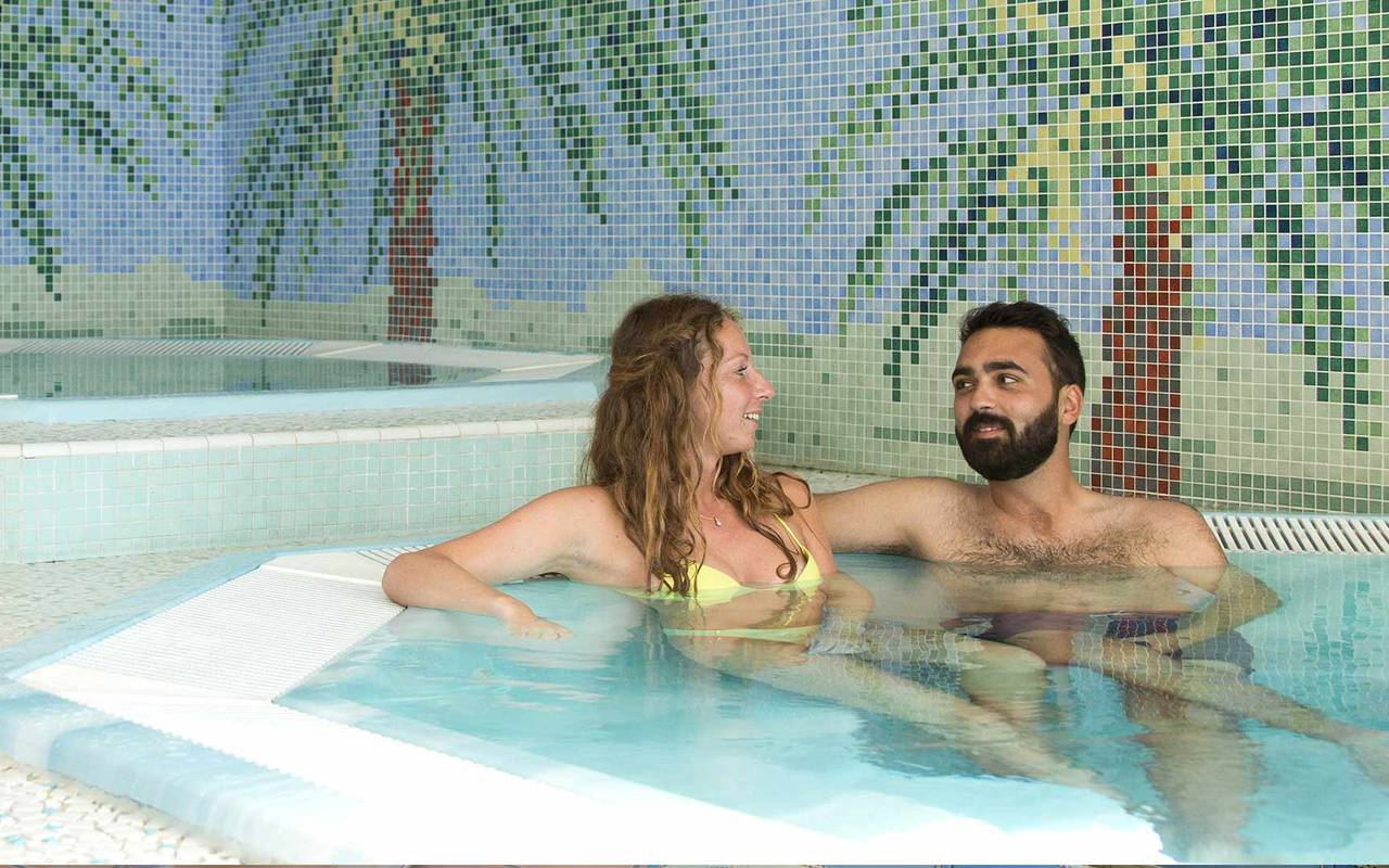 Man and woman bathing hotel swimming pool pyrenees